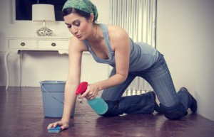 a-housekeeper-on-her-knees-washing-the-floor