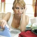 woman doing housework ironing